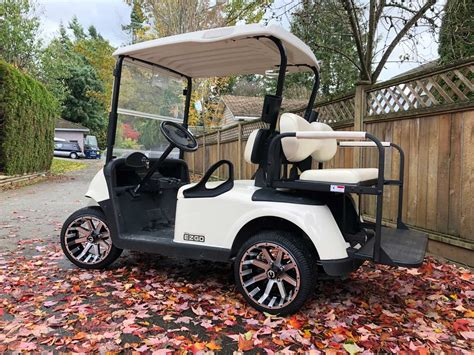 """2017 EZGO WHITE RXV Golf Cart 2+2 with 14"""" Custom rims and"""