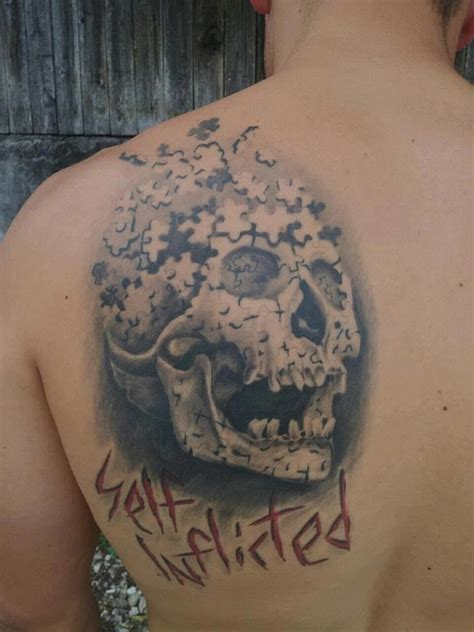 Puzzle Tattoos You'll Go to Pieces Over - Puzzling Face | Guff