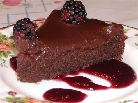 Decadent Chocolate Cake On A Bed Of Raspberry Sauce Recipe