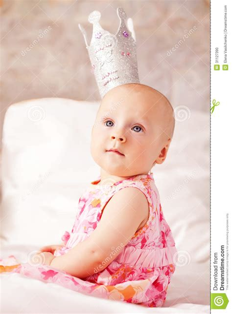 Little Baby Girl Wearing Beautiful Dress With Crown Stock